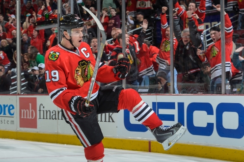 CHICAGO, IL - MARCH 16: Jonathan Toews #19 of the Chicago Blackhawks celebrates after scoring against the Detroit Red Wings in the third period during the NHL game on March 16, 2014 at the United Center in Chicago, Illinois. (Photo by Bill Smith/NHLI via Getty Images)